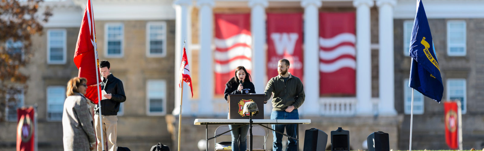 photo of students making a Memorial Day presentation on Bascom Hill