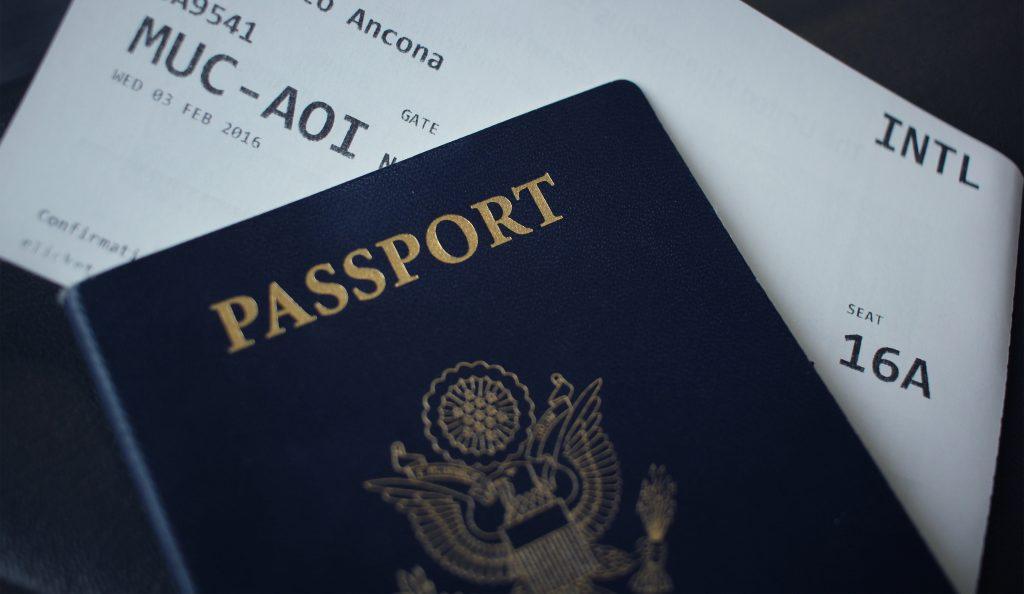 passport with plane ticket