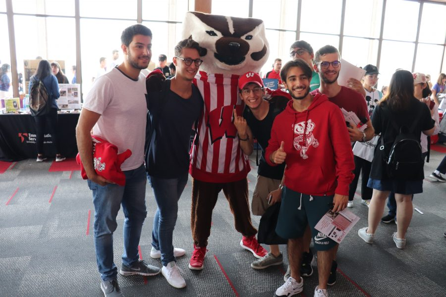 Bucky with new students at the International Student Welcome & Information Fair